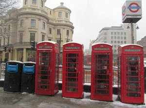Beyond Fleet Street, lies The Strand, and at the western end of it, opposite Charing Cross Station, are these four red telephone boxes...