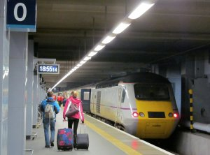 So here's Platform 0, with a couple about to board the 7 o'clock train to Newcastle. in the north-east of England...