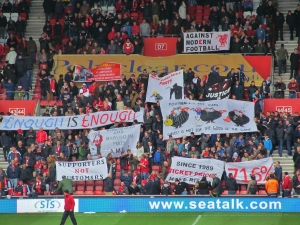 Liverpool fans before the match, protesting about corporate greed...