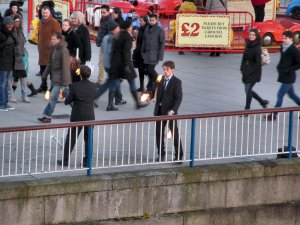 The two said fire jugglers, as viewed from Hungerford Bridge...