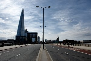 On London Bridge, looking south...with The Shard, to the left, dwarfing Southwark Cathedral, to the right...
