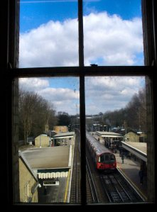 Through a station window at Totteridge and Whetstone Tube Station, looking north towards High Barnet