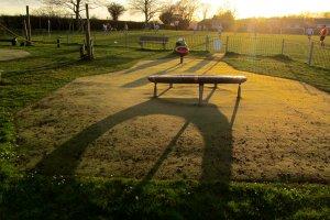 Long evening shadows, and a football match beyond...