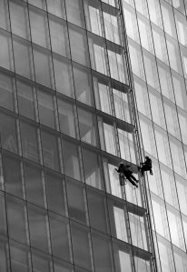 Two men scaling The Shard...