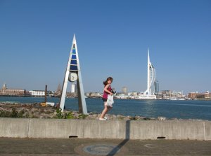 Clock, girl and Spinnaker Tower...
