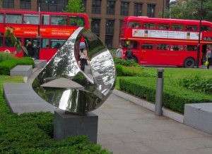Sculpture, and London buses, St Paul's Churchyard
