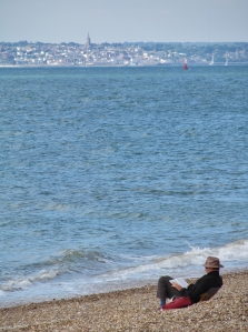 Relaxing on Southsea beach, and with Ryde, Isle of Wight, on the distant shoreline