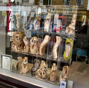 Ballet pumps, in a shop window of one of the many shops selling dance-wear in the Covent Garden area...