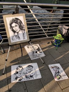 The work of a portrait sketch artist on Hungerford Bridge...