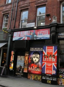 Monmouth Street, WC2, in the heart of London's Theatre-land...