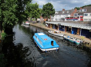 A valedictory view of Norwich, the River Wensum, with my B & B, The Station Hotel in Riverside Road, just visible behind the back of the double-decker bus...