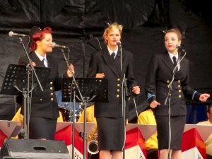 The Three Belles, singing 'Beat me Daddy, Eight to the Bar'