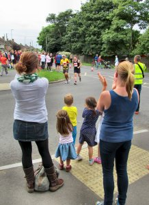 'Come on Dad!'...some young kids have just spotted their dad (in the yellow top)...