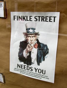 Poster in the window of a shop in Finkle Street, Richmond...