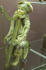 A Pierrot, circa 1900, when wound up, his hands play the harp...