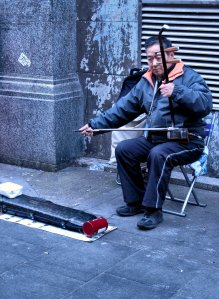 Busking with an erhu, in Gerrard Street, Chinatown, London...