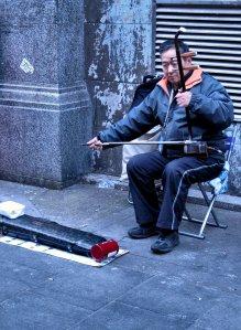 Busking with an erhu, in Gerrard Street, Chinatown, London...