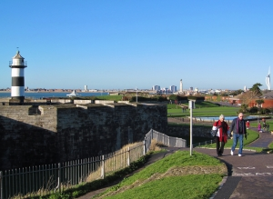 Nearing Southsea Castle, with its lighthouse, and visible in the distance are both the Naval War Memorial and at the extreme right, the Spinnaker Tower in Portsmouth Harbour...