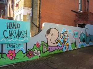 A hand car washing business on the southern side of Albert Road, artwork by Fark, a talented local graffiti artist...